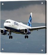 jetBlue A320 landing with mountain Acrylic Print