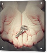 Key In Woman's Hand In Gesture Of Giving. Concept Of Success In Live, Business Solution, Real Estate Etc Acrylic Print