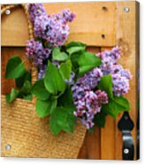 Lilacs In A Straw Purse Acrylic Print
