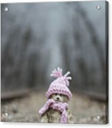 Little Teddy Bear Sitting In Knitted Scarf And Cap In The Winter Forest Between The Rails Acrylic Print