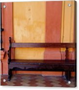 Long Wooden Bench Against A Yellow Wall At The Alcazar Of Seville Acrylic Print