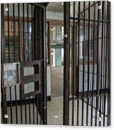 Metal Bars Leading Into Cellblock In Prison Acrylic Print