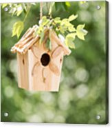 New Wooden Birdhouse Hanging On Tree Branch Outdoors  Acrylic Print