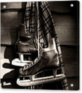Old Hockey Skates With Scarf Hanging On A Wall Acrylic Print