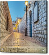 Old Stone Alleyway With Electric Lights Acrylic Print by Noam Armonn