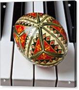 Painted Easter Egg On Piano Keys Acrylic Print