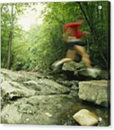Panned View Of Man Leaping Over Rocky Acrylic Print by Skip Brown