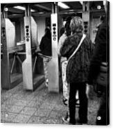 passengers moving through exit turnstiles in subway station New York City USA Acrylic Print