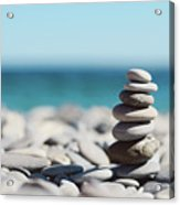 Pile Of Stones On Beach Acrylic Print by Dhmig Photography