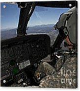 Pilot Operating The Cockpit Of A Uh-60 Acrylic Print