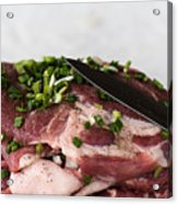 Pork meat with green garlik and knife Acrylic Print
