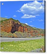 Red Cliffs And White Clouds Over Interstate 80 Rest Stop In Utah  Acrylic Print