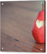 Red Pear With Heart Shape Bit Acrylic Print by Danielle Donders - Mothership Photography