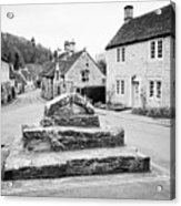remains of the buttercross in the centre of Castle Combe village wiltshire england uk Acrylic Print