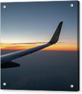 Right Wing Of Airplane In Mid Air With Sunrise In The Background Acrylic Print