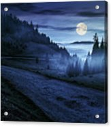 Road Near Foggy Forest In Mountains At Night Acrylic Print