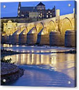 Roman Bridge On Guadalquivir River At Dawn Acrylic Print