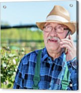 Senior Gardener Talking On The Phone With A Client. Acrylic Print