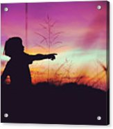 Silhouette Of A Playful Boy Pointing With Finger In The Field During Beautiful Sunset Acrylic Print