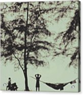 Silhouette Of A Young Men With Crossed Hands Above His Head Camping Hammocking In The Nature Acrylic Print