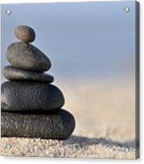 Stack Of Black Pebbles On Beach Acrylic Print