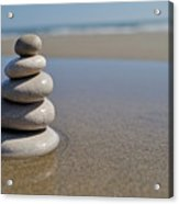 Stack Of Pebbles On Beach Acrylic Print
