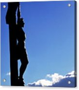 Statue Of Jesus Christ On The Cross Against A Cloudy Sky Acrylic Print