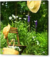 Straw Hat Hanging On Clothesline Acrylic Print by Sandra Cunningham