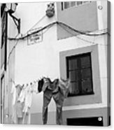 street in Porto with hanging clothes Acrylic Print