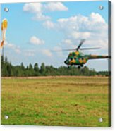 The Helicopter Over A Green Airfield. Acrylic Print