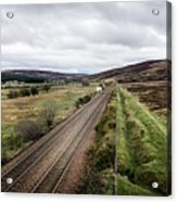 The Railroad To....in Scotland With Clouds Hanging Over The Mountains. Acrylic Print