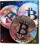 Three Bitcoin Coins In A Colorful Lighting. Acrylic Print
