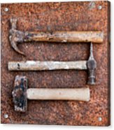 Three Hammers Against A Rust Background Acrylic Print
