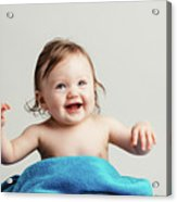 Toddler With A Cozy Blanket Sitting And Smiling. Acrylic Print