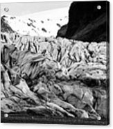 tourists at ash covered Skaftafell glacier and end moraine Vatnajokull national park in Iceland Acrylic Print