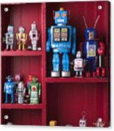Toy Robots On Shelf  Acrylic Print by Garry Gay