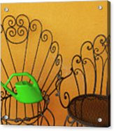 Two Black Iron Chairs And A Green Watering-can  Laid  On The Big Acrylic Print