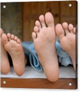 Two Children Lying In Bed Focus On Feet Acrylic Print