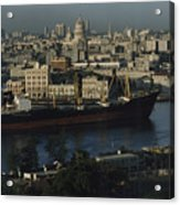 View Of City And A Massive Freighter Acrylic Print by James L. Stanfield
