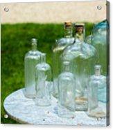 Vintage Glass Bottles On Table Acrylic Print