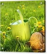 Watering Can In The Grass Acrylic Print by Sandra Cunningham
