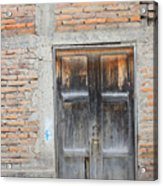 Weathered Wood Door In An Adobe Brick Wall Acrylic Print