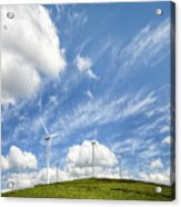 Wind Turbines On A Hill Under A Blue Sky Acrylic Print
