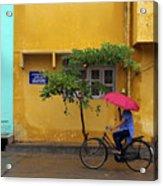 Woman Cycling In Street Acrylic Print