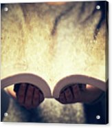Woman Holding An Open Book Bursting With Light. Acrylic Print