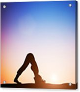 Woman In Dolphin Yoga Pose Meditating At Sunset Acrylic Print