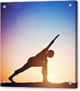 Woman Standing In Revolved Side Angle Yoga Pose Meditating At Sunset Acrylic Print
