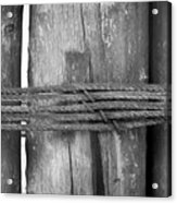 Wood Pilings Tied With Old Rusted Rope Acrylic Print
