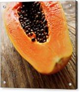 A Halved Fresh Papaya On A Wooden Acrylic Print