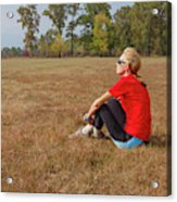 A Woman Is  Sitting In A Park And Admiring The Landscape Acrylic Print